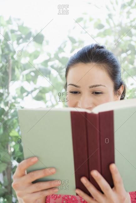 Caucasian woman reading book