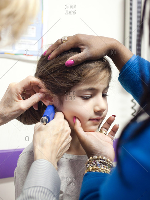 Ear being pierced