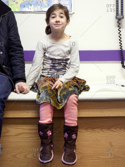 Young girl sitting in a waiting room