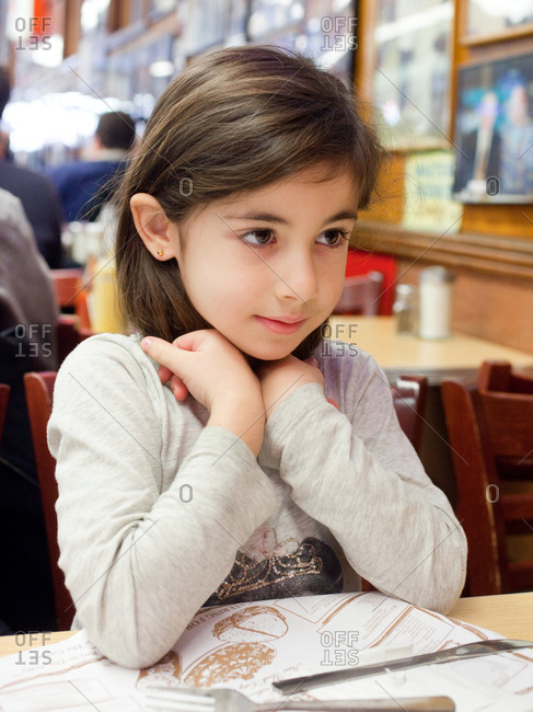Young girl in a restaurant