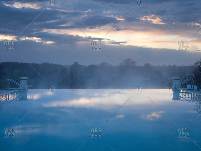 Scape of infinity pool and forest