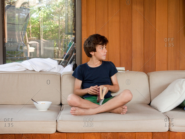 Young boy sitting on the sofa