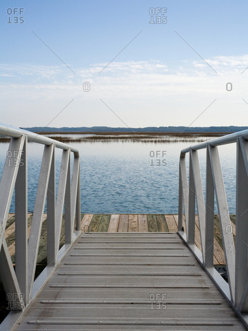 Empty deck leading to wooden pier