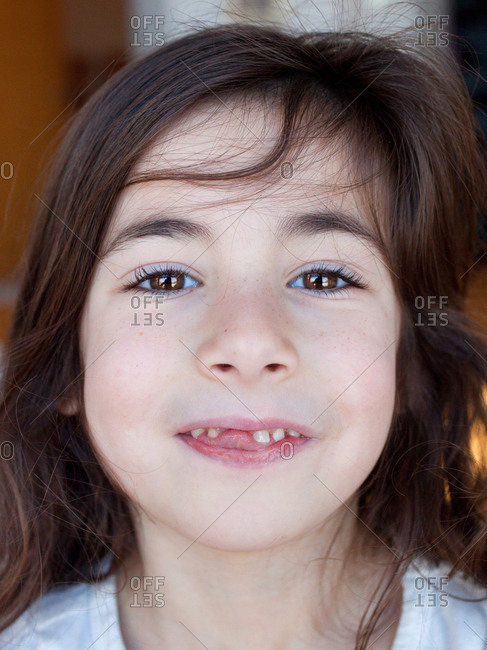 Portrait of young girl with missing tooth