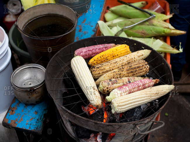 Different corn cobs on grill