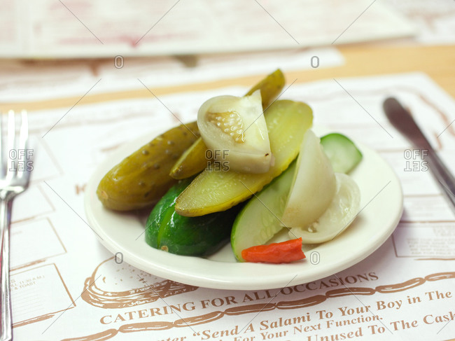 Green pickles served on plate