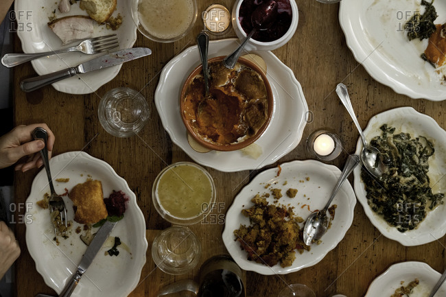 Thanksgiving menu with smoked turkey, cornbread stuffing, creamed collard greens and spiced sweet potato souffle