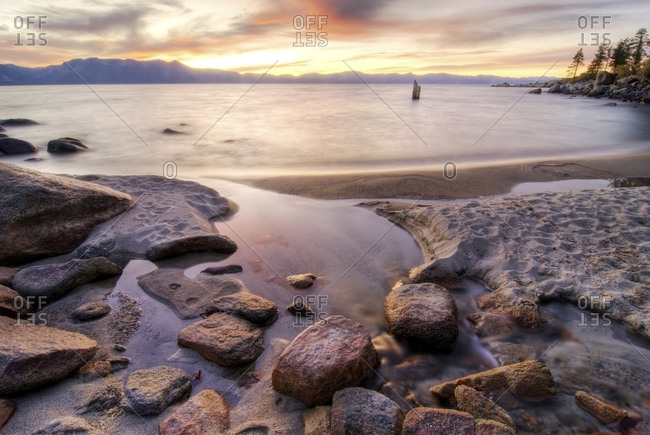 One of Lake Tahoe's 64 tributaries flows into the lake at sunset on the east shore, Nevada