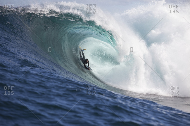 A surfer bodyboarding a dangerous wave at Shipstern bluff, in Tasmania