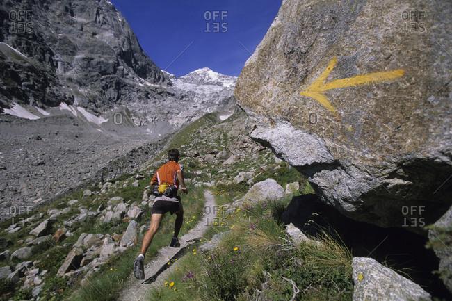 Man trail running in Val De Malatra, Courmayeur, Italy