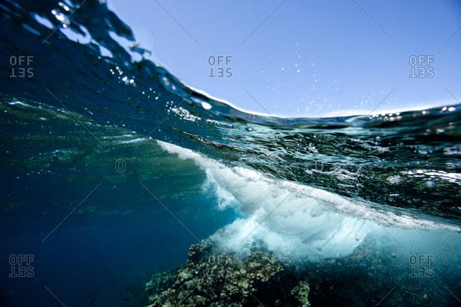Underwater view of crashing waves