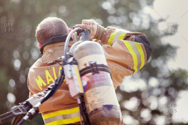 Fireman carrying an oxygen tank