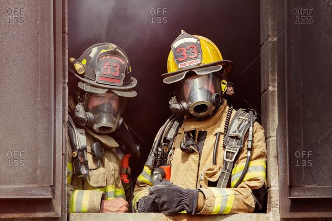 Firemen wearing protective gear