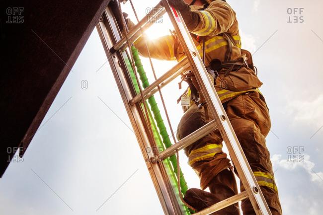 Fireman climbing up a ladder