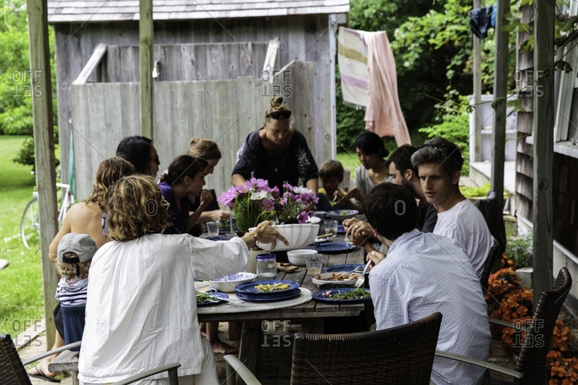 Young people eating and talking during garden party