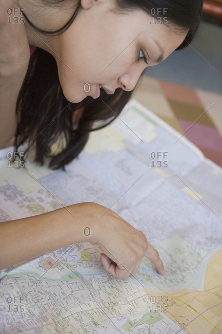 Young Native American woman pointing on map