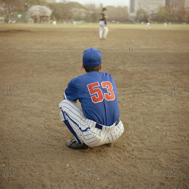 Baseball player crouching on the field