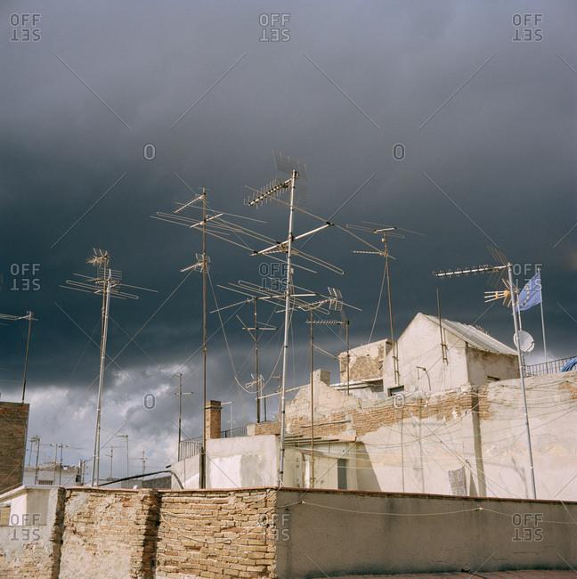Multiple TV-antennae against an overcast sky
