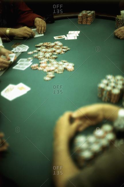 Group of people gambling at a casino blackjack table