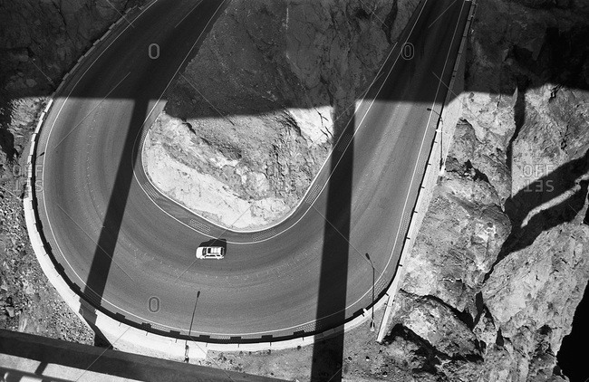 A car on a two lane highway, high angle view