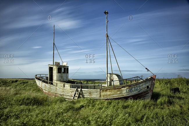 Abandoned Boat in a field