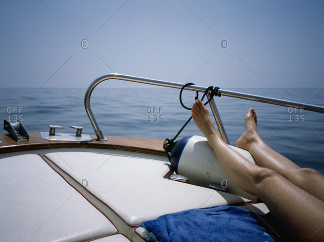 A woman sunbathing on a boat deck