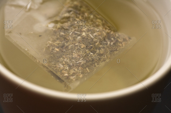 Detail of a teabag in a cup of water