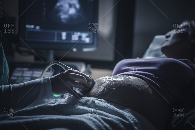 Pregnant woman having sonogram - Offset