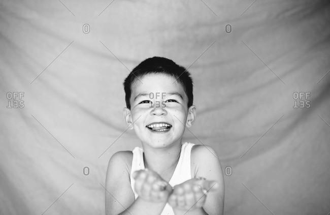 Happy young boy laughing