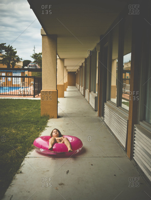 A young child naps in an inner tube