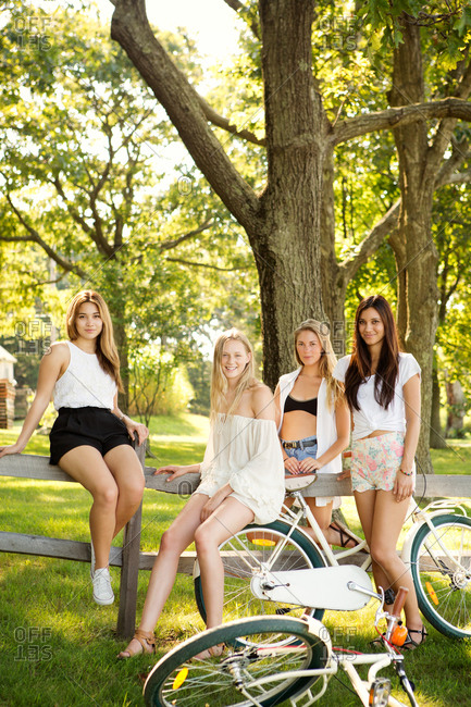 Group of pretty girls in nature looking at camera