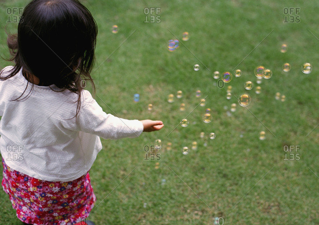 Girl catching bubbles - Offset Collection