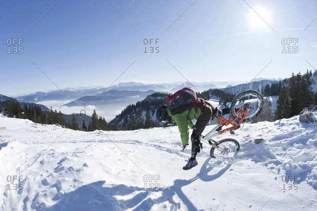 Man on mountainbike having an accident