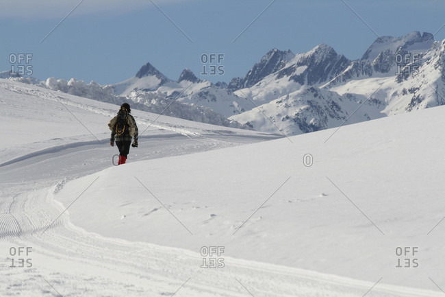 A woman walking in the mounatins, Graubuenden, Switzerland