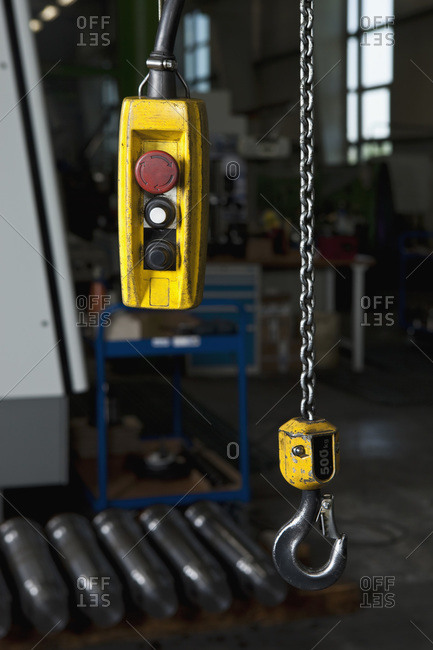 A chain hoist and its control in a metal parts factory
