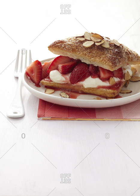 Strawberry napoleons with prosecco cream sprinkled with toasted almond.