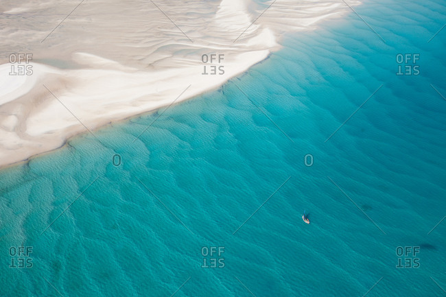 Traditional boat sailing among sand drifts, Mozambique