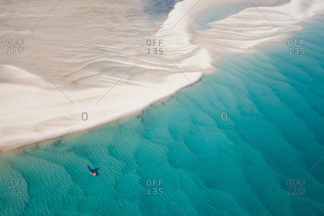 Beautiful view of traditional boat sailing among sand drifts, Bazaruto Archipelago, Mozambique