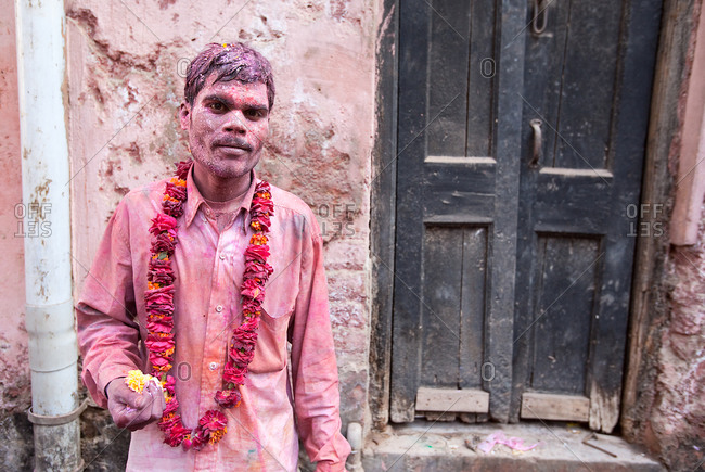Indian man covered in chalk to celebrate the Holi Festival in Mathura, India