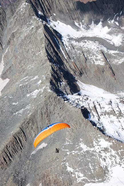 Paraglider flying over the Himalayan Mountains in Bir, India