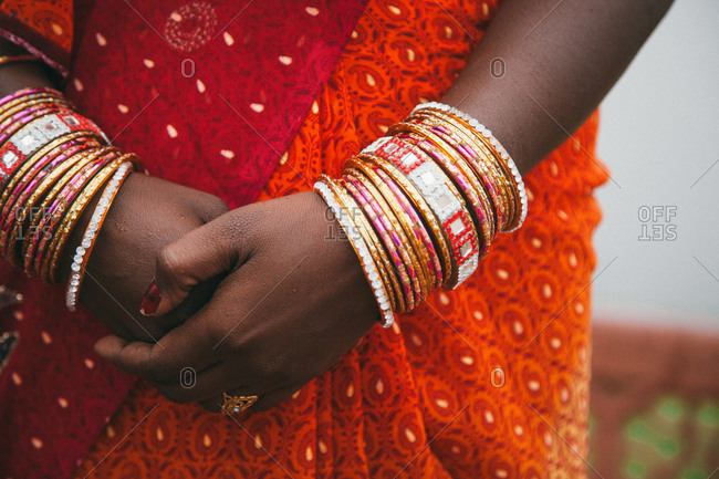Mid-section view of traditional Indian woman wearing Indian bracelets in Agra, India