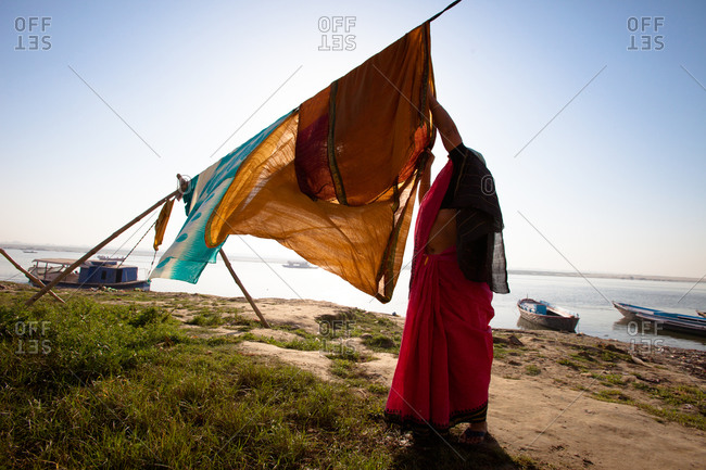Indian woman hanging laundry in Varanasi, India