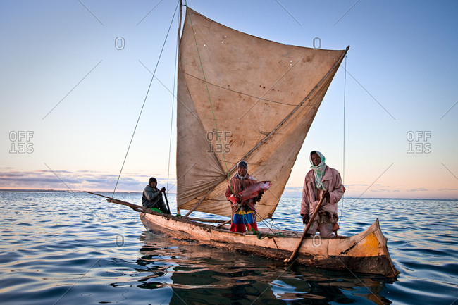 Vezo fishermen in traditional outrigger vessel in Madagascar