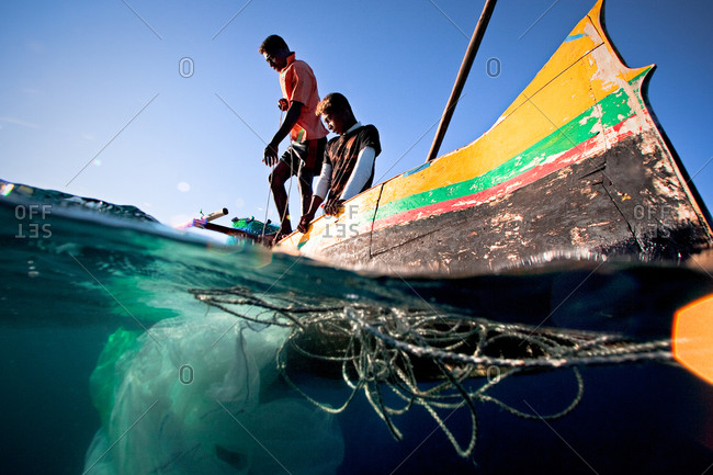 Young fishermen in traditional fishing pirogue in Madagascar