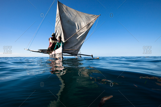 Vezo fishermen in traditional outrigger vessel, in Madagascar