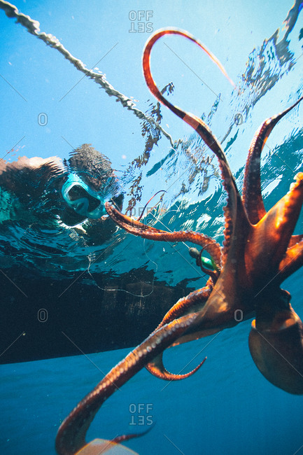 Vezo fisherman with octopus seen below in Madagascar