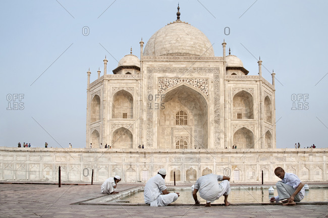 Cleansing ritual before prayer at the Taj Mahal, Agra, Uttar Pradesh, India.