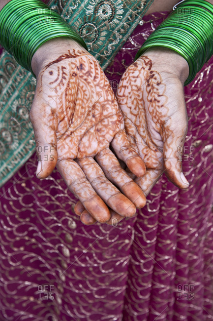 An Indian woman's hands covered with henna. Agra, India.