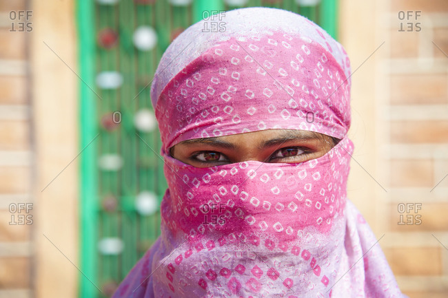 Woman worker smiling behind her head scarf in Jodhpur, India