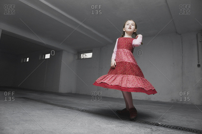 A young girl wearing a red dress